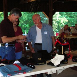 Attendees to a Round Table summer picnic at Argus Park look at the uniforms and equipment of Civil War soldiers.(Image Courtesy Gordy Morgan)