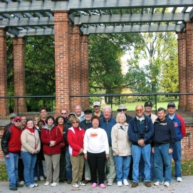 Tour attendees stop for a group picture at the Rostrum inside the Soldiers' National Cemetery at Gettysburg National Military Park. (Image Courtesy Jerry Arnsberger)