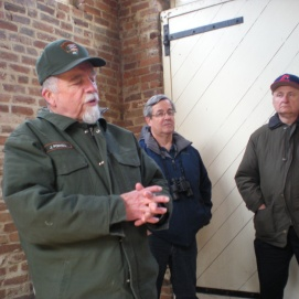 Several members of the group listen to a National Park Service describe the events of John Brown's Raid at Harpers Ferry during a Round Table tour of the park. (Image Courtesy Dan Welch)