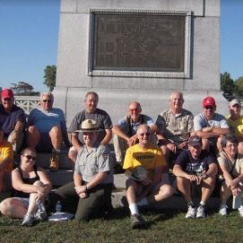 Attendees on a trip to Gettysburg pause for a group photo with member and National Park Service Ranger Dan Welch. (Image Courtesy Jerry Arnsberger)