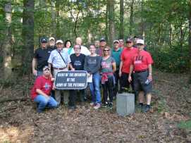 "In the fall of 2018, attendees to ""Sites of the Gettysburg Campaign"" trip were treated to a rare opportunity to visit Lost Avenue and get our group picture with this War Department marker on the battlefield. (Image Courtesy Jerry Arnsberger)"