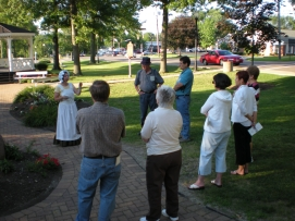Attendees to the tour of historic Canfield hear the history of the town's green by Canfield Historical Society President Suzanne McCabe. (Image Courtesy Dan Welch)